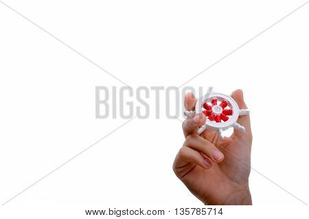 Isolated Ship steering wheel on hand on white background