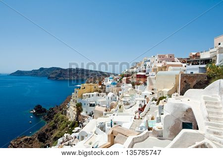 Oia town looking north towards the Therasia island on the island of Santorini Greece.