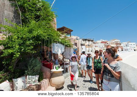THERAOIA-JULY 28: Tourists on the Oia street on July 242018 in Oia town on the Thera(Santorini) island Greece.