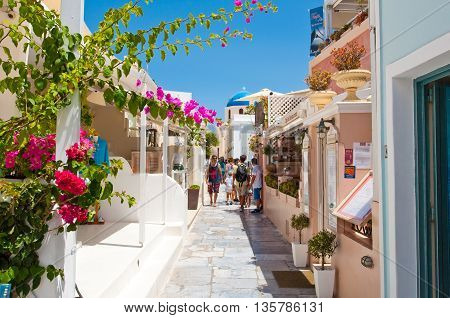 SANTORINIOIA-JULY 28: Shopping street on July 282014 in Oia town on Santorini Greece. Oia is a small town on the islands of Thira (Santorini) and Therasia Greece.