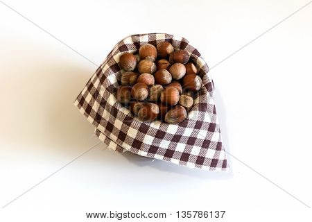 Fresh organic hazelnuts on a white background