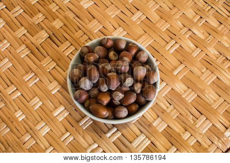 Fresh Organic Hazelnuts on a wicker background