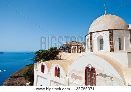 Orthodox church overlooking the caldera and the volcano. Fira Santorini in Greece.