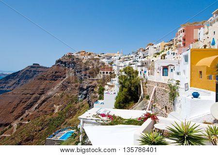 SANTORINIFIRA-JULY 28: Fira landscape on the edge of caldera on July 282014 in Fira town on Santorini Greece. Fira is the modern capital of the Greek Aegean island Santorini.