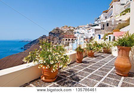 Idyllic patio with flowers in Fira town on the island of Thera(Santorini) Greece.