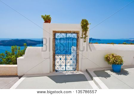 Door from the patio in Fira town on the island of Thira (Santorini) Greece.