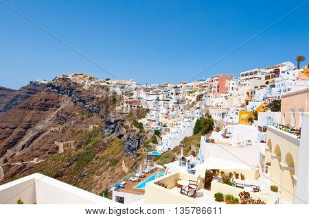 Aerial view of Fira town on the edge of the caldera cliff on the island of Thira (Santorini) Greece.