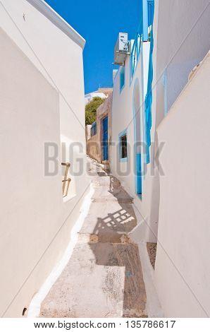 Narrow street in Fira town on Santorini (Thira) Greece.
