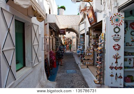 SANTORINI FIRA-JULY 28: Shopping street with souvenirs shops on July 28 2014 in Fira town on the Santorini island Greece. Firá is the modern capital of the Greek Aegean island Santorini.