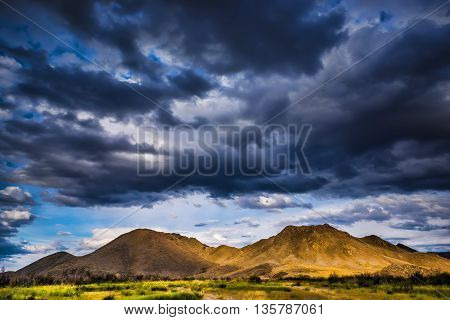 Stormy clouds in a blue sky over the mountains