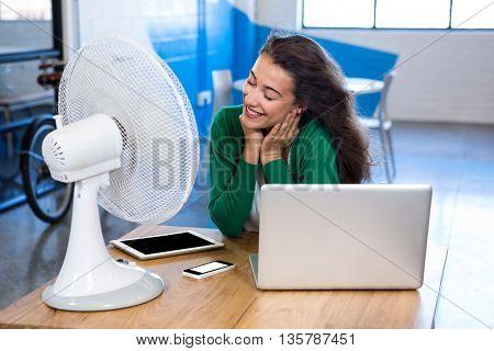 Woman enjoying a breeze in office
