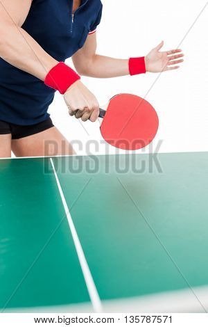 Ping pong player hitting the ball on white background