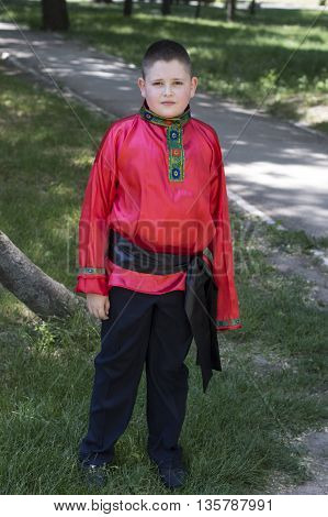 the boy in the Russian red shirt against park a subject people and holidays