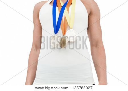 Female athlete wearing medals on white background