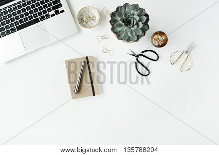 feminini desk workspace with succulent laptop scissors diary and golden clips on white background. flat lay top view
