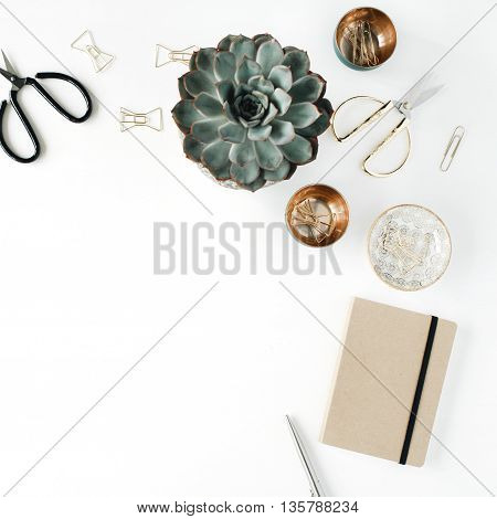 feminini desk workspace with succulent scissors diary and golden clips on white background. flat lay top view