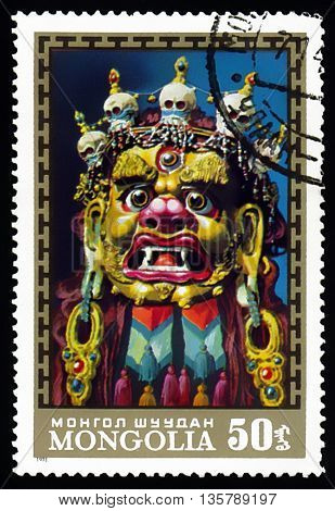 MONGOLIA - CIRCA 1971: A stamp printed in the MONGOLIA shows Cham Dance mask circa 1971