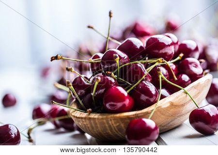 poster of Cherries. Sweet Cherries. Fresh Cherries. Ripe cherries on wooden concrete table - board.