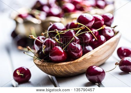 Cherries. Sweet Cherries. Fresh Cherries. Ripe cherries on wooden concrete table - board.