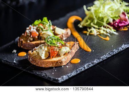 toasts with mozzarella and tomato