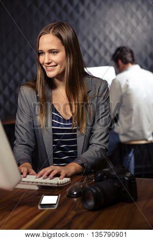 Creative businesswoman using computer in office