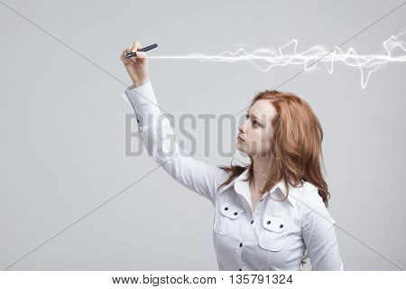 Woman making magic effect - flash lightning. The concept of copywriting or writing.