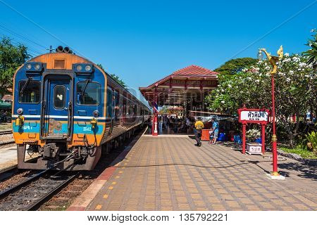 Hua Hin Thailand - Dec 26 2015: Hua Hin railway station with train and people on platform