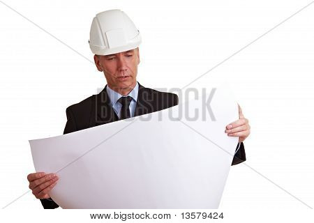 Architect Looking At Construction Prints