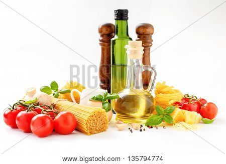 Spaghetti and fettuccine with ingredients for cooking pasta on a white background. Italian food cooking ingredients