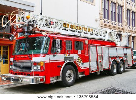 NEW ORLEANS, USA - MAY 14, 2015: Fire Engine of the New Orleans Fire Department on Bourbon Street in French Quarter.