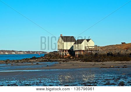 beautiful coastal fishing shacks at low tide