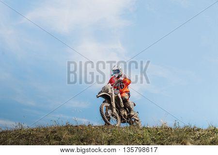 biker on mountain on blue sky background