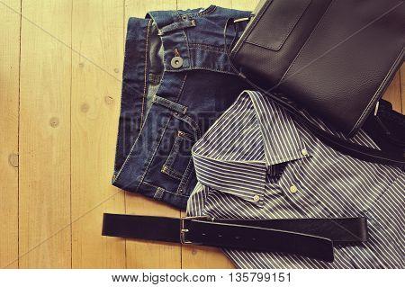 mens clothing worn flat on wood background