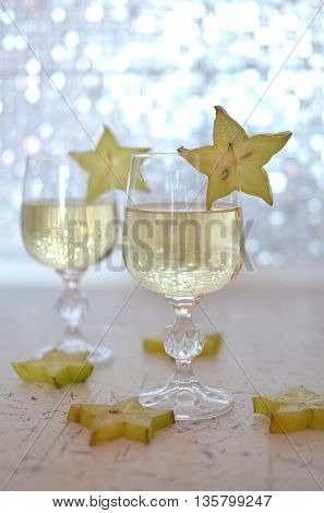 Two wineglasses of champagne decorated with fruit