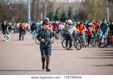 Gomel, Belarus - April 10, 2015: Young female police officer is on Lenin Square in Homel