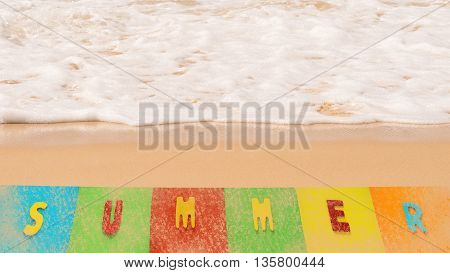 Colorful of summer word on beach with soft white wave foam of the sea on sandy beach. Summer time at sea beach concept.