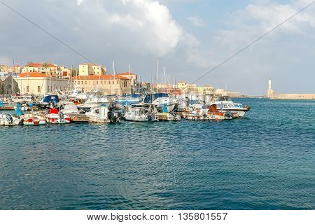 Fishing boats in the old harbor of Chania on a sunny day.