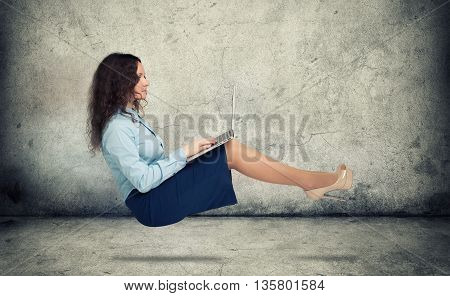 Woman Hanging In The Air With Laptop