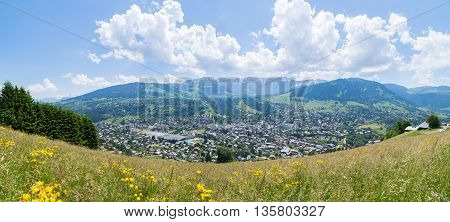 Panoramic view of the mountain village and ski resort of Megeve in the french alps during summertime.