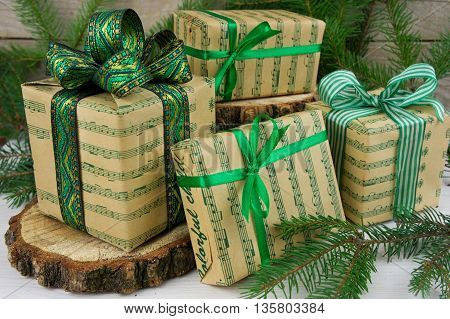 Christmas presents with tree branches green style