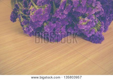 purple statice flowers on wooden Vintage tone