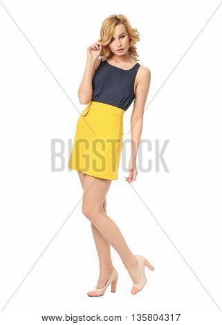Beauty Blonde Woman In Sexy Skirt Isolated On White