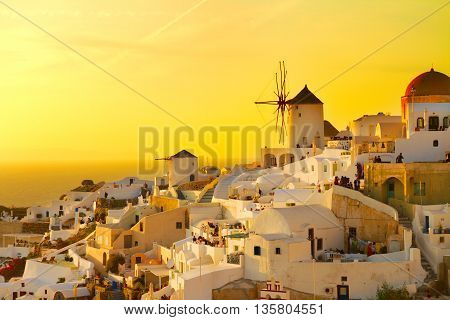 famouse orange sunset of Oia with windmill, Santorini