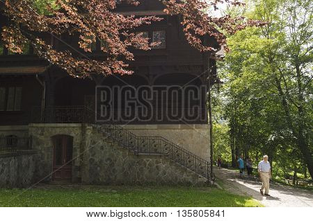 Sinaia, ROMANIA - June 18 2016: Tourists near Pelisor Castle in the Romanian city of Sinaia. SINAIA - June 18 2016