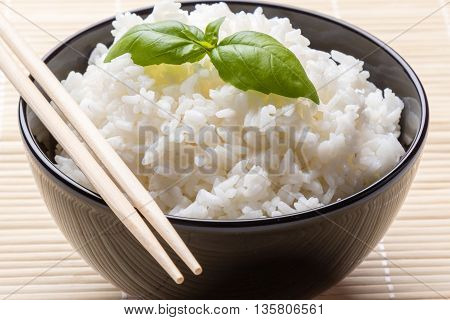Cooked Rice In Black Bowl