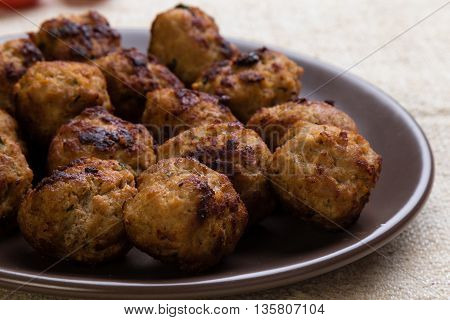 Meatballs On Brown Plate