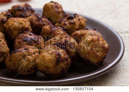Meatballs On Brown Plate