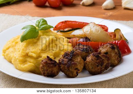 Polenta With Meatballs And Vegetables