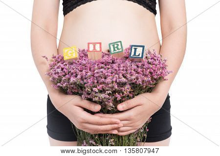 pregnant woman and alphabet blocks spelling GIRL on white background