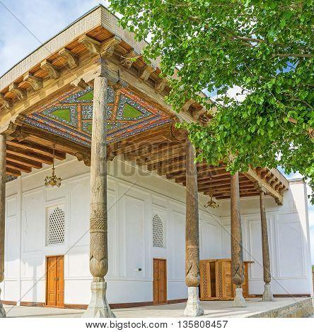 The corner view of the Khakim Kushbegi Mosque with the beautiful islamic patterns on the roof Bukhara Uzbekistan.